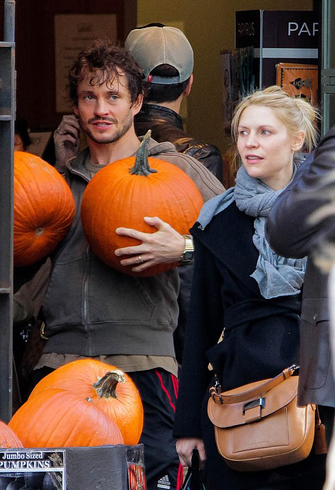 """EXCLUSIVE TO INF. ALL-ROUNDER. NO CANADA.October 21, 2012: Pregnant Claire Danes and her husband Hugh Dancy go shopping for pumpkins at Pusateri's in Toronto, Canada. The glowing new mom-to-be tries to hide her growing baby bump but a black trench coat just was't covering it. Danes is visiting Dancy, who is filming his new TV show """"Hannibal"""".This is the 33-year-old 'Homeland' actress' first child with husband, and fellow actor, Hugh Dancy. Danes and Dancy were married at an intimate ceremony in France back in September, 2009.Pictured here: Claire Danes, Hugh DancyMandatory Credit: Sean O'Neill/INFphoto.comRef.: infcato-05