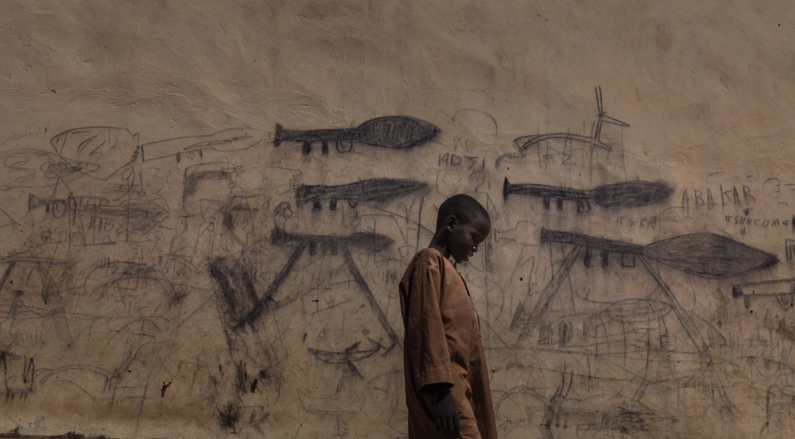 <p>A boy in the Chad Basin, where a humanitarian crisis is underway – caused by a complex combination of political conflict and environmental factors. (Marco Gualazzini) </p>