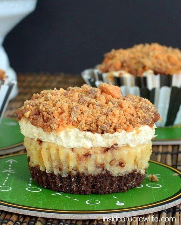 """<p>The perfect game day treat, these mini cheesecakes have a crunchy Butterfinger topping that makes for a delicious bite.</p><p><strong>Get the recipe at <a href=""""https://insidebrucrewlife.com/butterfinger-mousse-cheesecakes/"""" rel=""""nofollow noopener"""" target=""""_blank"""" data-ylk=""""slk:Inside BruCrew Life"""" class=""""link rapid-noclick-resp"""">Inside BruCrew Life</a>.</strong></p><p><strong><a class=""""link rapid-noclick-resp"""" href=""""https://www.amazon.com/AmazonBasics-Nonstick-Carbon-Steel-Muffin/dp/B073P4RPFP/?tag=syn-yahoo-20&ascsubtag=%5Bartid%7C10050.g.5080%5Bsrc%7Cyahoo-us"""" rel=""""nofollow noopener"""" target=""""_blank"""" data-ylk=""""slk:SHOP MUFFIN PANS"""">SHOP MUFFIN PANS</a><br></strong></p>"""