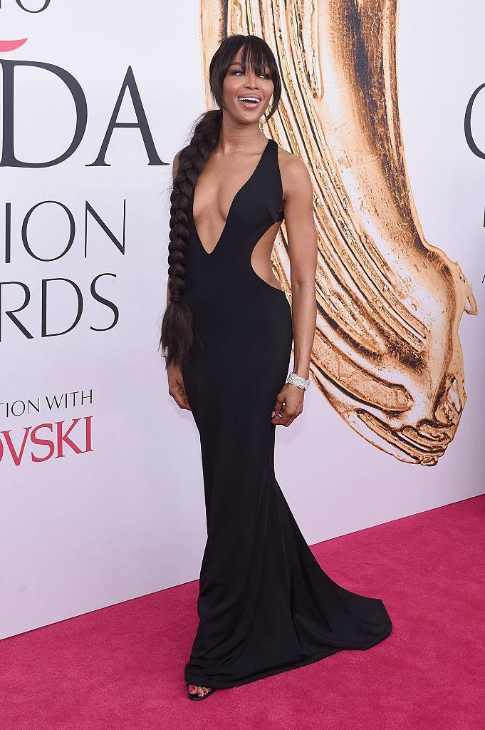 <p>Looking every bit like the supermodel she is in a curve-hugging Brandon Maxwell gown with cutout sides. <i>(Photo by Jamie McCarthy/Getty Images)<br></i><br></p>