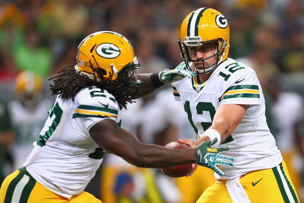 ST. LOUIS, MO - AUGUST 17: Aaron Rodgers #12 of the Green Bay Packershands the ball off to Eddie Lacy #27 of the Green Bay Packers during a preseason game against the St. Louis Rams at the Edward Jones Dome on August 17, 2013 in St. Louis, Missouri. (Photo by Dilip Vishwanat/Getty Images)