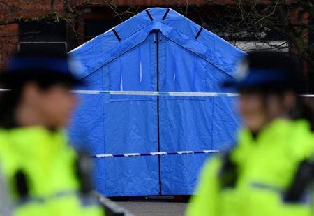 Police officers stand guard in front of a forensics tent in a cordoned off area in the centre of Salisbury, Britain, March 7, 2018. REUTERS/Toby Melville