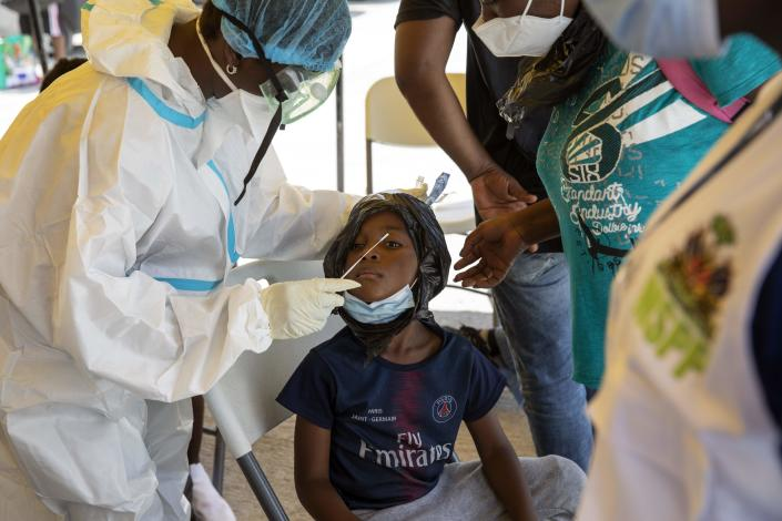 A little boy who was deported from the U.S. border with Mexico gets tested for COVID-19 at Toussaint Louverture International Airport in Port-au-Prince, Haiti, Monday, Sept. 20, 2021. The U.S. is flying Haitians camped in a Texas border town back to their homeland. (AP Photo/Rodrigo Abd)