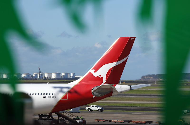 A file picture shows the tail part of a Qantas Airways aircraft seen through a decorative window from the international terminal at Sydney Airport.