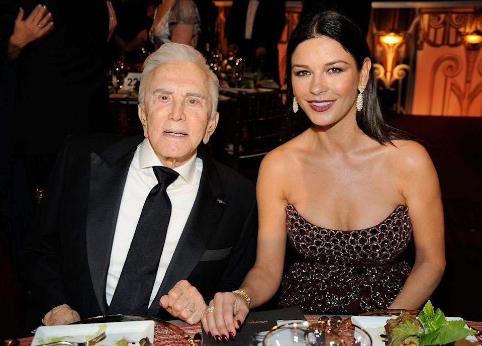 <p>Douglas with his daughter-in-law, actress Catherine Zeta-Jones, at an American Film Institute Lifetime Achievement Award event held in his honor. </p>