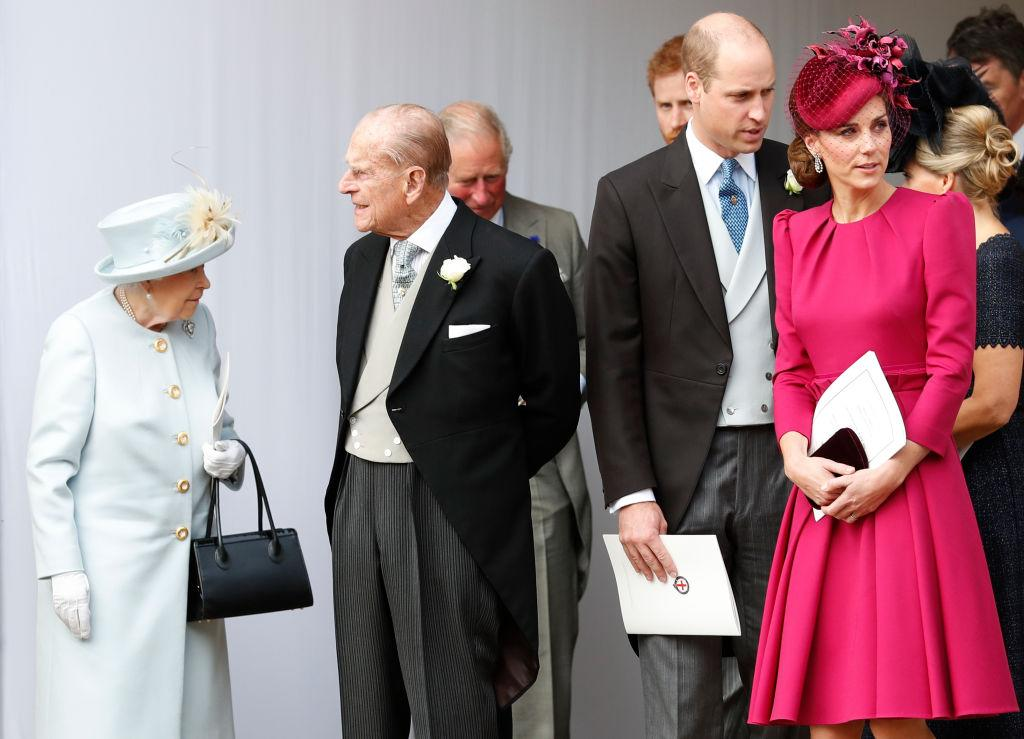 <p>Kate Middleton wears a ruby red A-line dress by Alexander McQueen and matching fascinator to the wedding of Princess Eugenie of York to Jack Brooksbank at St George's Chapel at Windsor Castle on Oct. 12, 2018. (Photo: Alastair Grant/WPA Pool/Getty Images) </p>