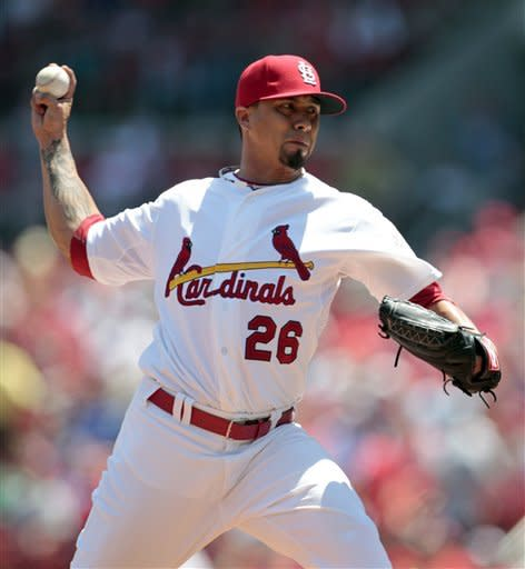 St. Louis Cardinals starting pitcher Kyle Lohse throws during the first inning of a baseball game against the Chicago Cubs, Tuesday, May 15, 2012, in St. Louis. (AP Photo/Jeff Roberson)