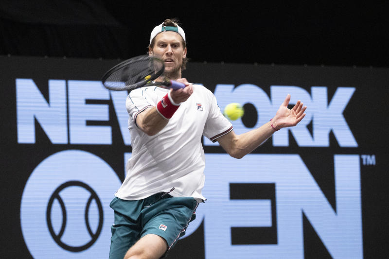 Andreas Seppi, of Italy, returns a shot to Kyle Edmund, of Britain, in the final of the New York Open tennis tournament Sunday, Feb. 16, 2020 in Uniondale, N.Y. (AP Photo/Mark Lennihan)
