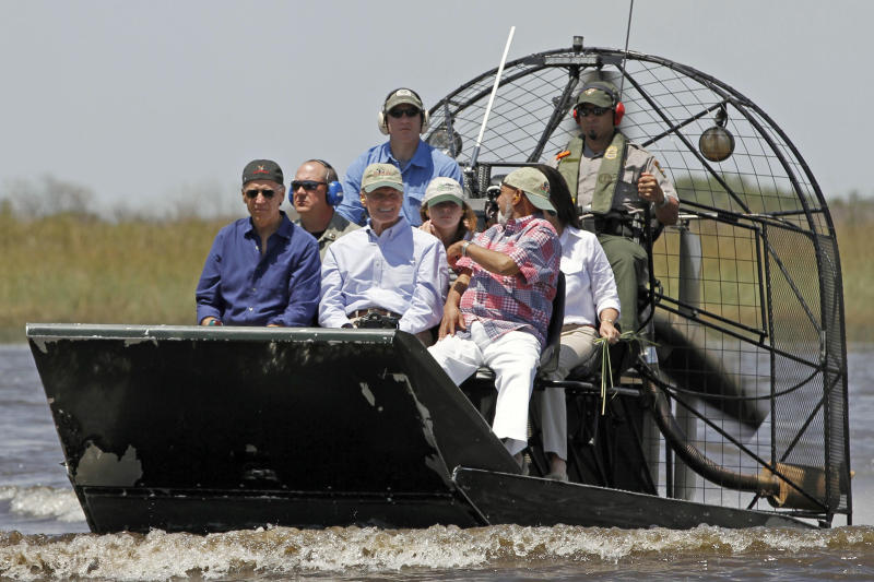 Vice President Joe Biden, left foreground, accompanied by Sen. Bill Nelson, D-Fla., center foreground, and  Rep. Alcee Hastings, D-Fla., right, foreground,  arrive at the Safari Hammock area in the Everglades National Park, Fla., Monday, April 23, 2012. (AP Photo/Alan Diaz)