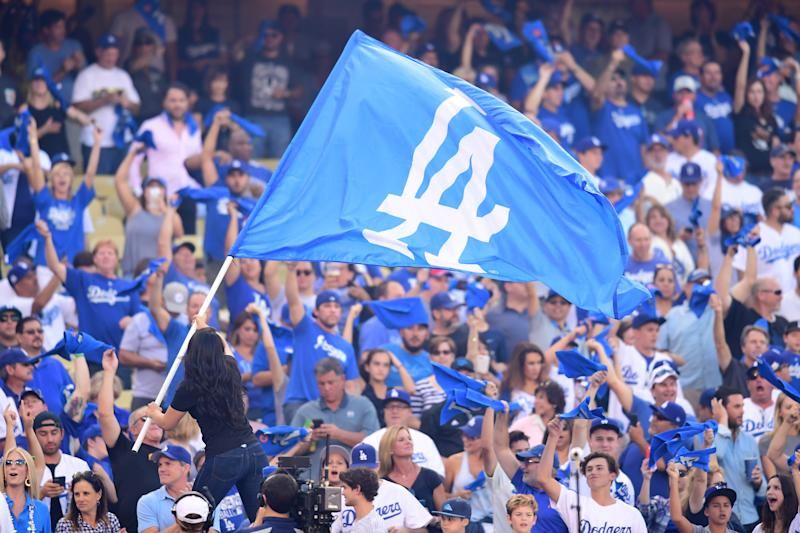 LOS ANGELES, CA - OCTOBER 14: Fans cheer as the Los Angeles Dodgers flag is waved prior to Game One of the National League Championship Series between the Chicago Cubs and the Los Angeles Dodgers at Dodger Stadium on October 14, 2017 in Los Angeles, California. (Photo by Harry How/Getty Images)