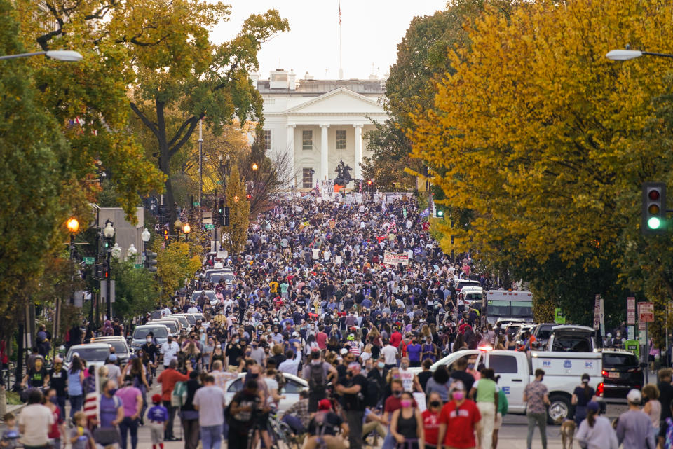 People gather along 16th street in front of the White House to celebrate the presidential race being called in favor of President-elect Joe Biden over President Donald Trump, Saturday, Nov. 7, 2020, in Washington. His victory came after more than three days of uncertainty as election officials sorted through a surge of mail-in votes that delayed the processing of some ballots. (AP Photo/Pablo Martinez Monsivais)