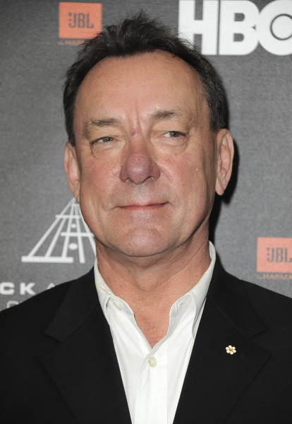 FILE - This April 18, 2013 file photo shows Neil Peart at the Rock and Roll Hall of Fame Induction Ceremony in Los Angeles. Peart, the renowned drummer and lyricist from the band Rush, has died. His rep Elliot Mintz said in a statement Friday that he died at his home Tuesday, Jan. 7, 2020 in Santa Monica, Calif. He was 67. (Photo by Jordan Strauss/Invision, File)