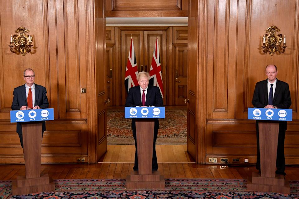 <p>Chief scientific adviser Sir Patrick Vallance (left) and Chief Medical Officer Professor Chris Whitty (right), listen to Prime Minister Boris Johnson speaking during a news conference</p>PA