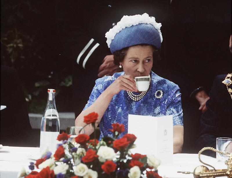NORTHERN IRELAND - 1977: Queen Elizabeth ll has a cup of tea while in Northern Ireland on a royal visit in 1977.(Photo by Anwar Hussein/Getty Images)