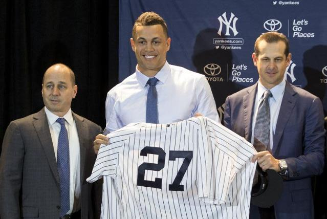 """<a class=""""link rapid-noclick-resp"""" href=""""/mlb/players/8634/"""" data-ylk=""""slk:Giancarlo Stanton"""">Giancarlo Stanton</a>'s power and determination are coming with him to New York. (AP)"""