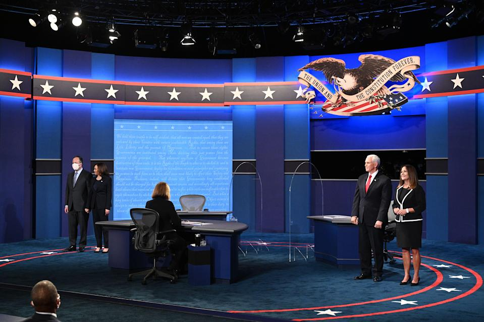 (From L) Husband of US Democratic vice presidential nominee and Senator from California, Kamala Harris, Douglas Emhoff, Harris, US Vice President Mike Pence Mike Pence and his wife Second Lady Karen Pence stand onstage after the vice presidential debate in Kingsbury Hall at the University of Utah on October 7, 2020, in Salt Lake City, Utah. (Photo by Robyn Beck / AFP) (Photo by ROBYN BECK/AFP via Getty Images)