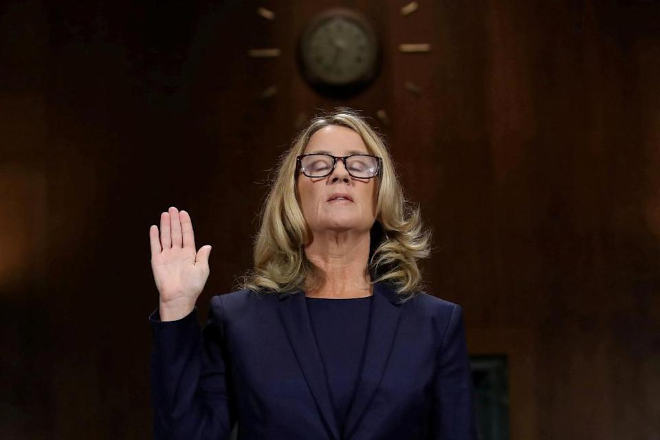 Christine Blasey Ford is sworn in before her testimony at the Senate judiciary committee in Washington DC on 27 September 2018.