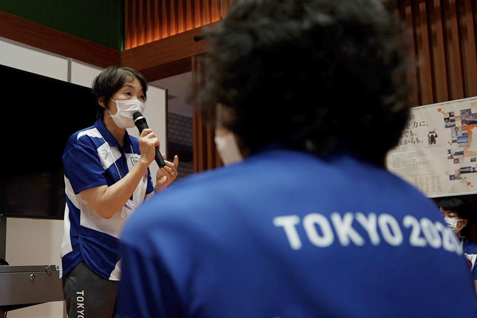 """Olympic volunteer Mieko Onuma talks about her experiences of the 2011 earthquake, also known as the Great East Japan Earthquake, at Tohoku Fukushi University in Sendai, Japan, Wednesday, July 28, 2021. The Tokyo Olympics was billed as the """"Recovery and Reconstruction Games,"""" with the torch relay starting in disaster-hit Fukushima and several events held in Fukushima and Miyagi. However, the coronavirus pandemic has disrupted opportunities to showcase the region's restoration to foreign spectators. (AP Photo/Chisato Tanaka)"""