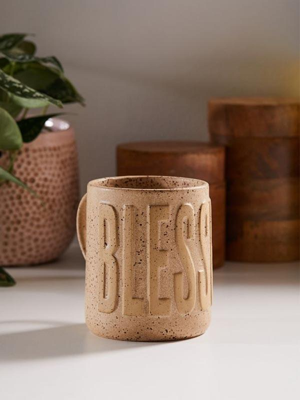 "With everything going on in the world right now, it's important to stay in tune with all your blessings—and this speckled mug is a stylish (and functional) reminder. $16, Urban Outfitters. <a href=""https://www.urbanoutfitters.com/shop/blessed-embossed-text-15-oz-mug?color=012&type=REGULAR&size=ONE%20SIZE&quantity=1"" rel=""nofollow noopener"" target=""_blank"" data-ylk=""slk:Get it now!"" class=""link rapid-noclick-resp"">Get it now!</a>"