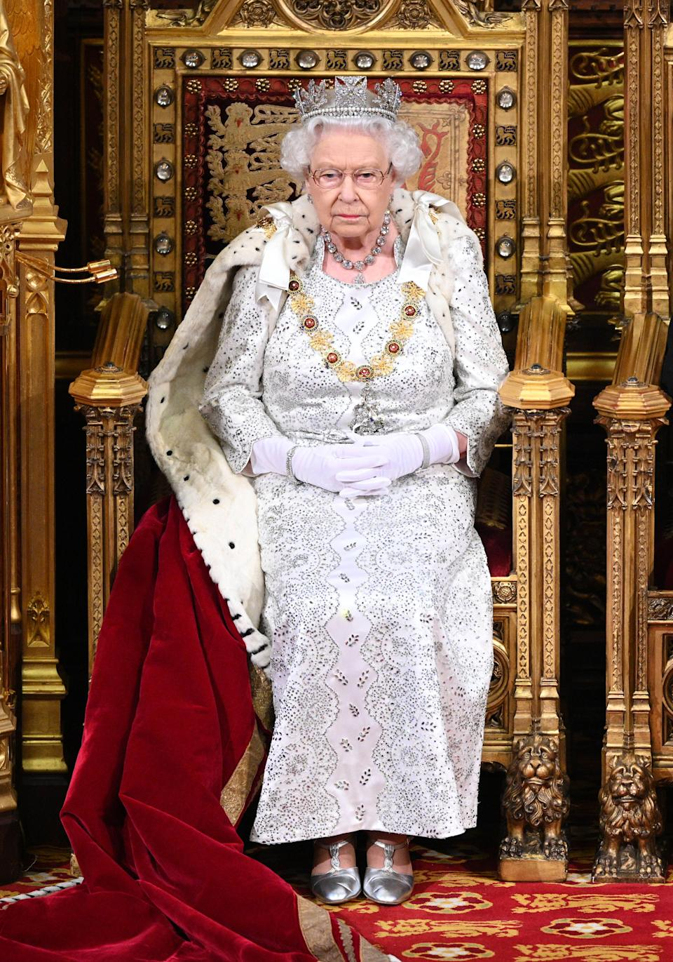 Britain's Queen Elizabeth II takes her seat on the The Sovereign's Throne in the House of Lords at the State Opening of Parliament in the Houses of Parliament in London on October 14, 2019. - The State Opening of Parliament is where Queen Elizabeth II performs her ceremonial duty of informing parliament about the government's agenda for the coming year in a Queen's Speech. (Photo by Paul Edwards / POOL / AFP) (Photo by PAUL EDWARDS/POOL/AFP via Getty Images)