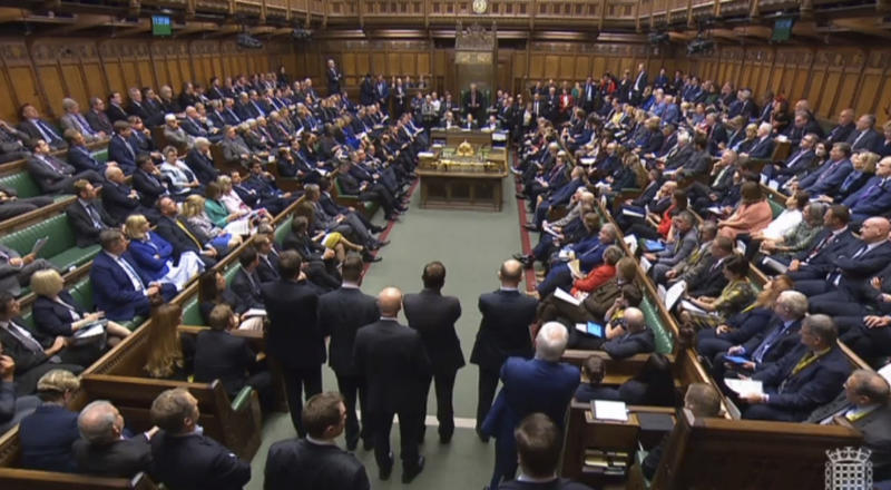 British lawmakers in the House of Commons, London, Wednesday Sept. 25, 2019. Britain's House of Commons reconvened on Wednesday following the bombshell Supreme Court ruling that Prime Minister Boris Johnson had acted illegally by suspending Parliament — in effect stymieing efforts to consider laws surrounding Brexit. (Parliament TV via AP)