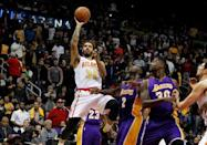 Dec 4, 2015; Atlanta, GA, USA; Atlanta Hawks forward Mike Scott (32) shoots the ball against the Los Angeles Lakers in the fourth quarter at Philips Arena. The Hawks defeated the Lakers 100-87. Mandatory Credit: Brett Davis-USA TODAY Sports