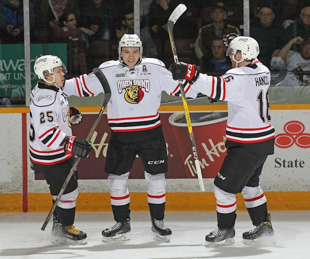 Nick Suzuki (centre) has put up some ridiculous numbers during his time in the OHL.