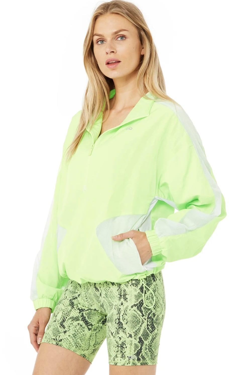 <p>Neon pieces like this <span>Alo Yoga Renewal Half Zip Pullover</span> ($158) bring an energizing burst of color to any outfit.</p>