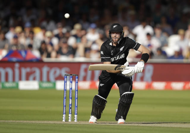 New Zealand's Martin Guptill hits runs off the bowling of Australia's Mitchell Starc during the Cricket World Cup match between New Zealand and Australia at Lord's cricket ground in London, Saturday, June 29, 2019. (AP Photo/Matt Dunham)