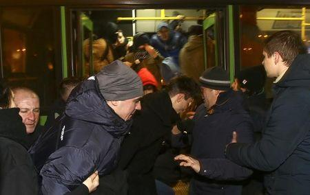 Members of law enforcement state agencies, dressed in plain clothes, attempt to detain participants of a protest against new taxes and increased tariffs for communal services in Minsk, Belarus, February 17, 2017. REUTERS/Vasily Fedosenko