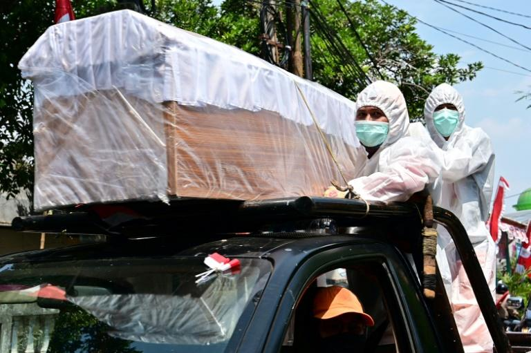 Indonesia stages coffin parade as reminder of virus threat