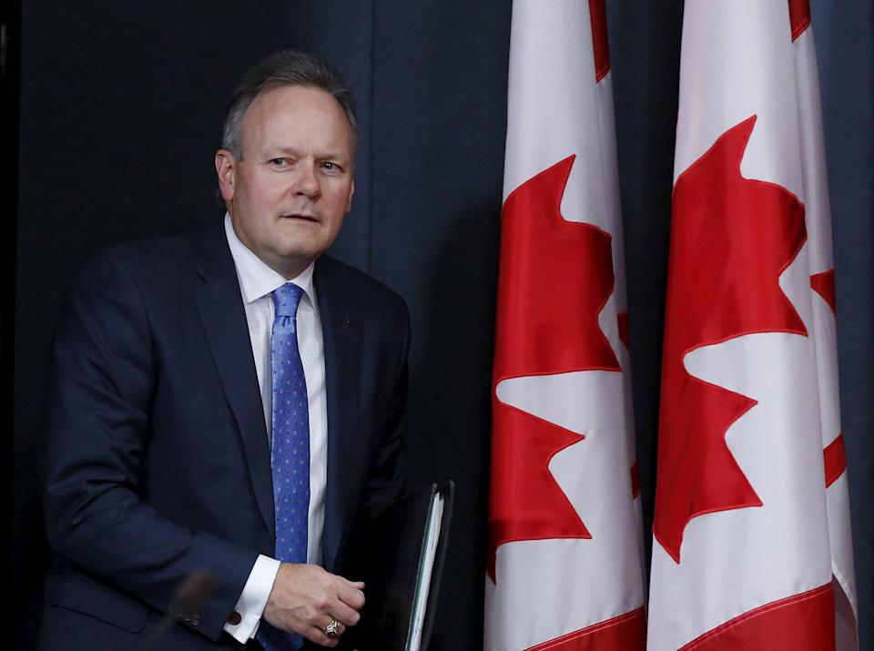 Bank of Canada Governor Stephen Poloz arrives at a news conference upon the release of the Monetary Policy Report in Ottawa April 15, 2015. The Bank of Canada held its benchmark interest rate steady on Wednesday, saying the economy will pick up as non-energy exports and labor markets strengthen even though the oil price crash probably cut economic growth to zero in the first quarter. REUTERS/Chris Wattie