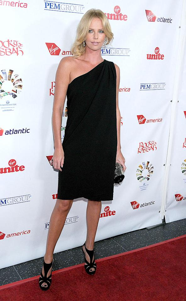 """You may not be feeling her messy mane, but you can't deny the chicness of Charlize Theron's asymmetric black Ralph Lauren dress and Dior heels, which the star strutted in at Sir Richard Branson's recent charity event at Hollywood's Roosevelt Hotel. Gregg DeGuire/<a href=""""http://www.wireimage.com"""" target=""""new"""">WireImage.com</a> - October 24, 2008"""