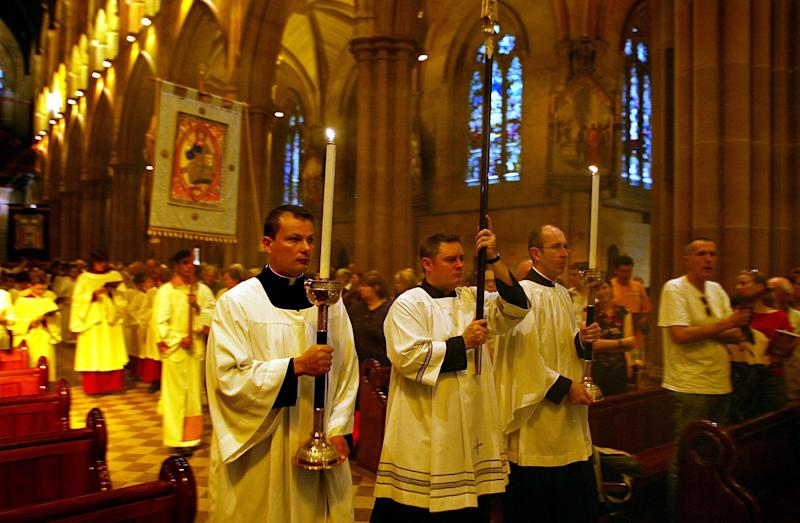 File photo shows clergy walking down the isle at the start of Mass in St Mary's Cathedral in Sydney (AFP Photo/Rob Elliott)