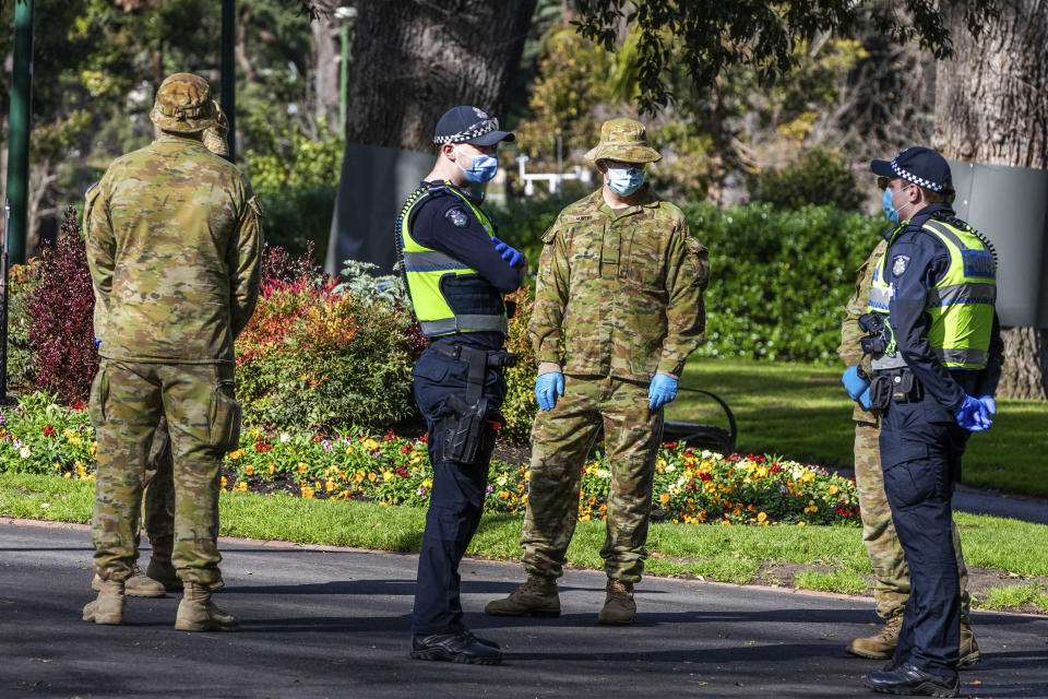 Australian Defence Force staff (ADF) and Victorian police are seen on patrol in Melbourne. Source: AAP