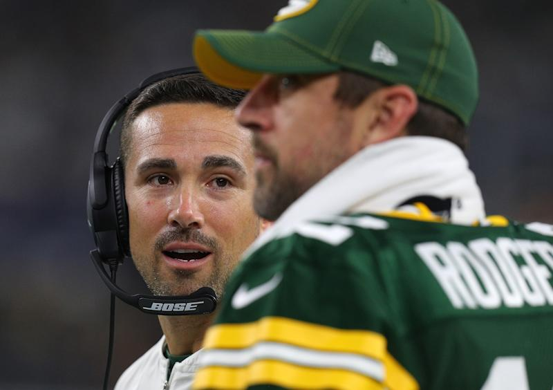 ARLINGTON, TEXAS - OCTOBER 06: Head coach Matt LaFleur of the Green Bay Packers talks with quarterback Aaron Rodgers #12 on the sidelines during the game against the Dallas Cowboys at AT&T Stadium on October 06, 2019 in Arlington, Texas. (Photo by Richard Rodriguez/Getty Images)