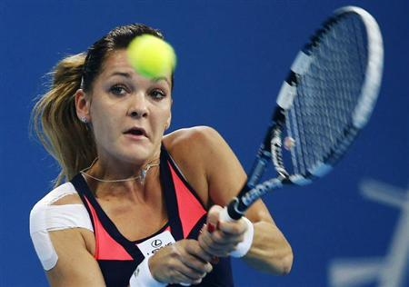 Agnieszka Radwanska of Poland hits a return during her women's singles semi-final match against Serena Williams of the U.S. at the China Open tennis tournament in Beijing October 5, 2013. REUTERS/Kim Kyung-Hoon