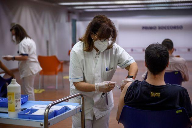 ROME, ITALY - JUNE 03: A boy receives a dose of the AstraZeneca (Vaxzevria) COVID-19 vaccine at the Vaccine Hub Auditorium della Tecnica in the Confindustria headquarters, as part of an open week for vaccinations with no age limit, on June 3, 2021 in Rome, Italy. According the Italian government, just over 20 percent of Italians are fully vaccinated, with 37 percent having received a first dose, on par with the European average. (Photo by Antonio Masiello/Getty Images) (Photo: Antonio Masiello via Getty Images)