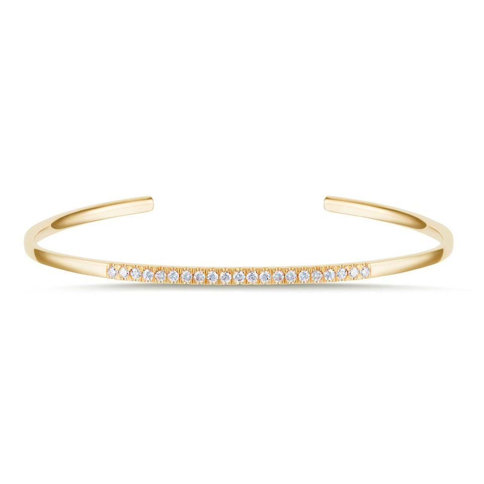 """<p><strong>Carbon & Hyde</strong></p><p>carbonandhyde.com</p><p><strong>$2300.00</strong></p><p><a href=""""https://carbonandhyde.com/collections/bracelets/products/half-infinity-bangle-yellow-gold"""" rel=""""nofollow noopener"""" target=""""_blank"""" data-ylk=""""slk:Shop Now"""" class=""""link rapid-noclick-resp"""">Shop Now</a></p><p>Handcrafted from gleaming 14-karat gold, this understated cuff is decorated with 0.35 carats of diamonds. Stack it with similar pieces from the label. </p>"""