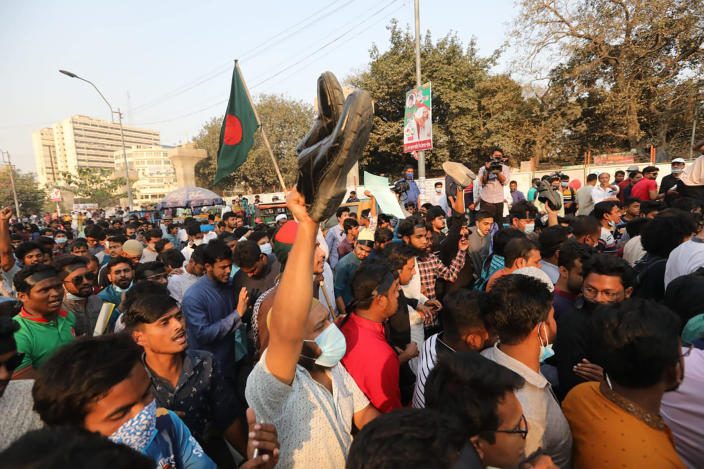 Protesters shout slogans as they protest the death in prison of a writer who was arrested on charges of violating the sweeping digital security, in Dhaka, Bangladesh, Friday, Feb. 26, 2021. Mushtaq Ahmed, 53, was arrested in Dhaka in May last year for making comments on social media that criticized the Prime Minister Sheikh Hasina government's handling of the coronavirus pandemic. He had been denied bail at least six times. (AP Photo/Mahmud Hossain Opu)