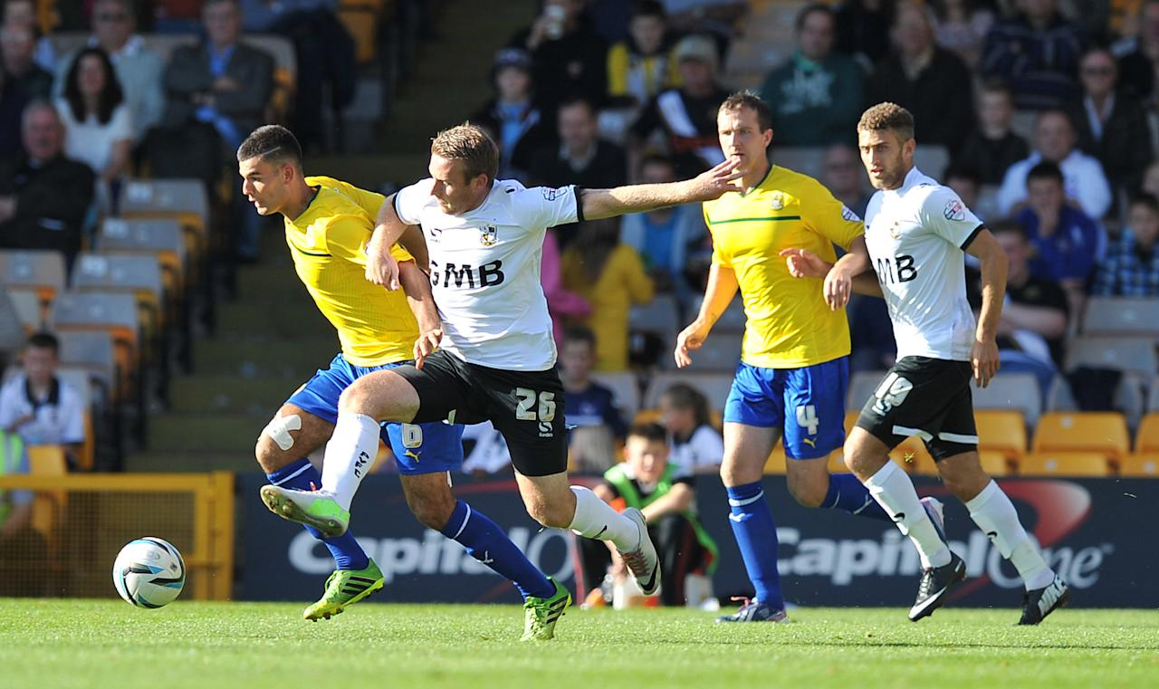 Coventry City's Conor Thomas (left) battles with Port Vale's Chris Birchall (right) during the Sky Bet League One match at Vale Park, Stoke.