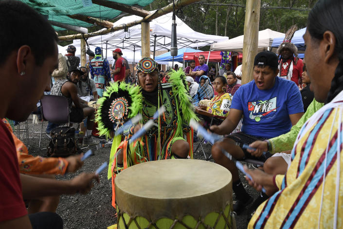 **HOLD FOR STORY BY SUSAN HAIGH** Drum group Ho-Chunk Station from Wisconsin perform during Schemitzun at the Mashantucket Pequot Tribal Nation, in Mashantucket, Conn., Wednesday, Aug. 28, 2021. (AP Photo/Jessica Hill)