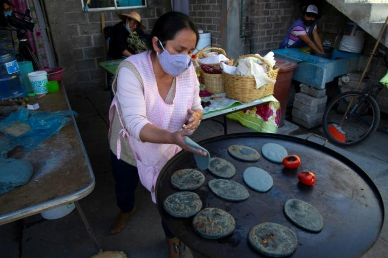 A member of the group Women of the Earth makes tortillas in a kitchen on the edge of Mexico City