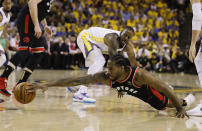 Toronto Raptors forward Kawhi Leonard, foreground, reaches for the ball in front of Golden State Warriors forward Andre Iguodala during the first half of Game 3 of basketball's NBA Finals in Oakland, Calif., Wednesday, June 5, 2019. (AP Photo/Ben Margot)