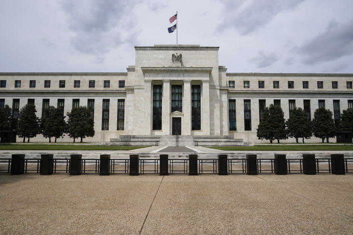 FILE - In this May 4, 2021, file photo is the Federal Reserve in Washington. The Federal Reserve is warning that the U.S. financial system remains vulnerable to threats stemming from the global pandemic, including a possible sharp rise in global interest rates that could strain developing countries. The Fed said in a report Thursday, May 6, that a worsening of the global pandemic could stress the financial system in emerging markets and some European countries. (AP Photo/Patrick Semansky, File)