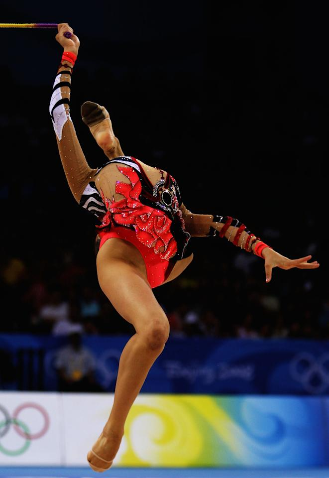 BEIJING - AUGUST 23:  Aliya Yussupova of Kazakhstan competes in the Individual All-Around final held at the University of Science and Technology Beijing Gymnasium on Day 15 of the Beijing 2008 Olympic Games on August 23, 2008 in Beijing, China.  (Photo by Mike Hewitt/Getty Images)
