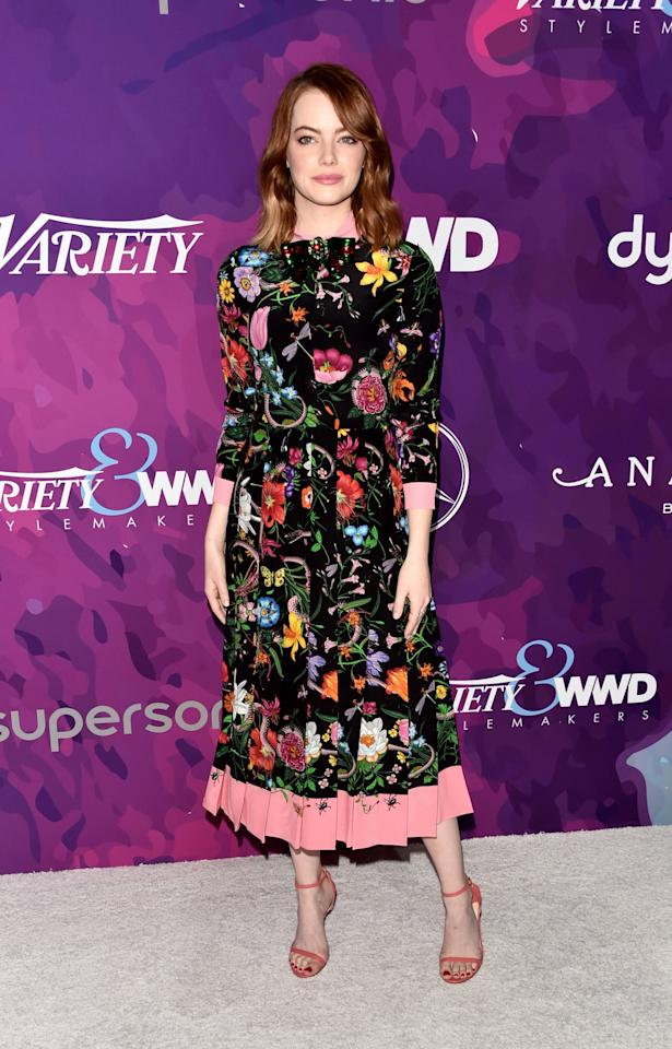 <p>The <em>La La Land</em> actress attended the event to honor both her makeup artist, Rachel Goodwin, and stylist, Petra Flannery. Her black tea-length frock with pink trim was classy and sophisticated. Yet the floral pattern, which also featured bugs, added a youthful — if creepy — twist. <em>(Photo: Getty Images)</em> </p>