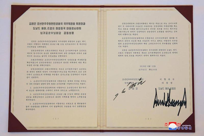 A photo released by the official North Korean Central News Agency (KCNA) shows agreement signed by Kim Jong-Un and Donald Trump in Singapore 12 June 2018. (Rex Features)