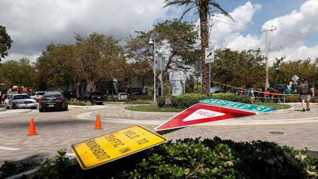 A street sign lies askew across the traffic circle from the Rehabilitation Center at Hollywood Hills in Hollywood, north of Miami, Florida, U.S., September 13, 2017. REUTERS/Andrew Innerarity