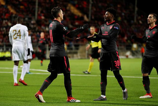 Soccer Football - Europa League Round of 32 First Leg - Ostersunds FK vs Arsenal - Jamtkraft Arena, Ostersund, Sweden - February 15, 2018 Arsenal's Mesut Ozil celebrates scoring their third goal with Ainsley Maitland-Niles and Henrikh Mkhitaryan Action Images via Reuters/Peter Cziborra